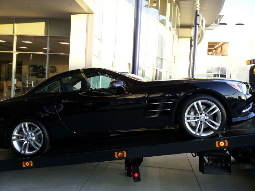 luxury car towing